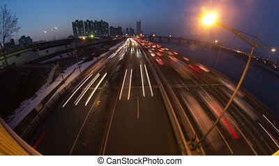 Seoul City 143 - 143) Time lapse of traffic and architecture...