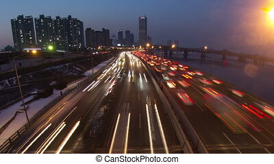 Seoul City Zoom 143 - 143) Zooming time lapse of traffic and...