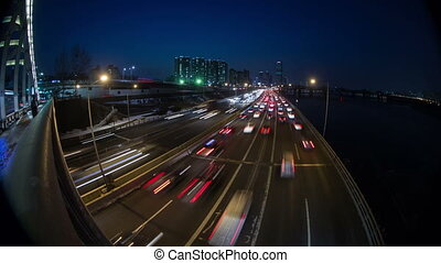 Seoul City 144 - 144) Time lapse of traffic and architecture...
