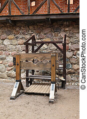 pillory and stocks in a medieval castle