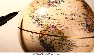 Old globe - Old miniature globe rotating