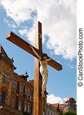 crucified on a wooden cross