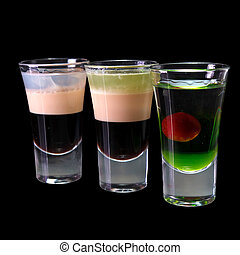 three cocktails layered shots isolated on the dark...