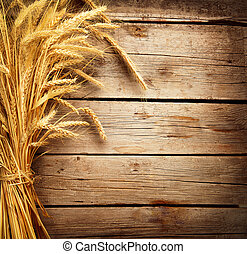 Wheat Ears on the Wooden Table. Harvest concept