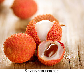 Lychee on a wooden table. Lichi Closeup. Selective focus