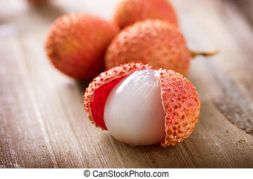 Lychee on a wooden table Lichi Closeup Selective focus