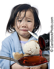 Sick Child - A young girl is sick and having her temperature...