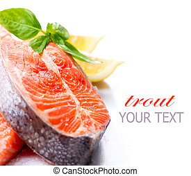 Raw Salmon Red Fish Steak with Herbs and Lemon isolated on...