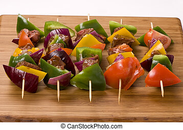 Kabobs - A plate full of fresh vegatables and meat for...