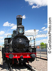 locomotive - steam locomotive on a background of blue sky