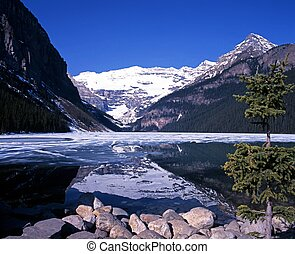 Lake Louise, Alberta, Canada - Partly frozen Lake Louise,...