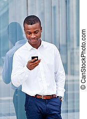 young successfil african businessman with mobilephone...