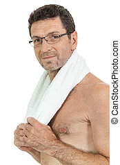 smiling mature sporty man with towel fittness sport health...