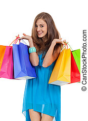 attractive young woman with colorful shopping bags isolated...