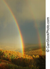 Double rainbow on a beautiful hills scenery in Tuscany,...