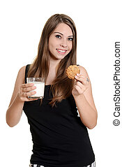 teen girl with glas milk and cookie - isolated teen girl...