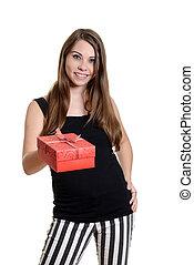 young girl giving christmas gift
