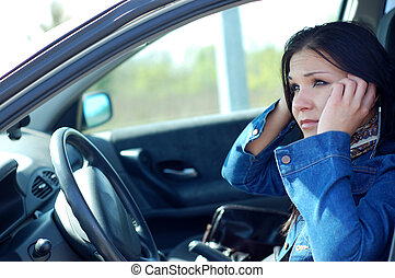car problem - angry woman with mobile phone in her car