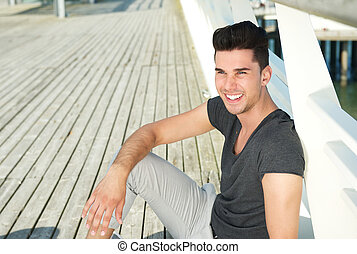 Portrait of an attractive young man smiling outdoors