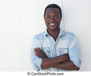 Portrait of a handsome black man with arms crossed