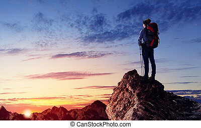 Young tourist atop of mountain - Image of young man...