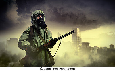 Stalker with gun - Man in gas mask and camouflage holding...