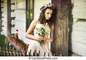 Young woman with bouquet of wild flowers - Young lady with...
