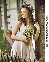 Cute country girl with bouquet - Cute country woman with...