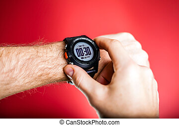 Runner checking sport watch XXXL - Male runner ready to run...