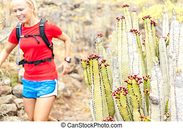 Young woman trail running in mountains