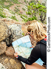 Trail runner checking map