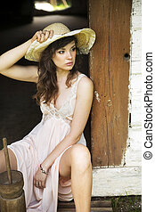 Brunette young lady wearing straw hat - Brunette young woman...