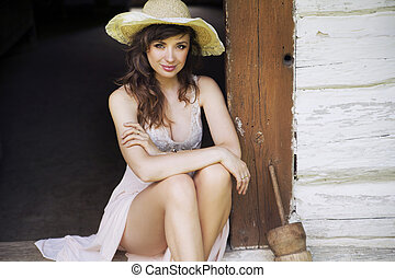 Beautiful brunette woman with straw hat - Beautiful brunette...