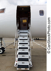 ladder in a private jet and asphalt and sky