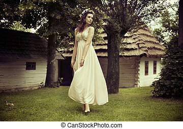 Lady in white dress dancing on the grass - Lady in white...