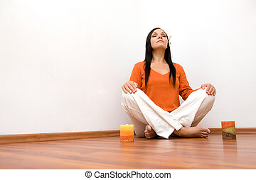 indoor meditation - attractive brunette woman meditation at...