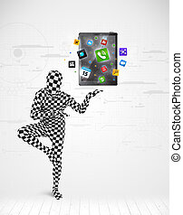 man in full body suit holdig tablet pc - Funny man in full...