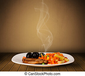 Fresh delicious home cooked food with steam on wood deck
