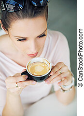 Attractive brunette lady taking a gulp of coffee -...