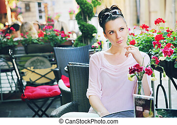 Cute woman waiting in the restaurant