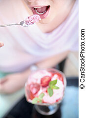 Attractive woman tasting a fruit dessert - Attractive lady...