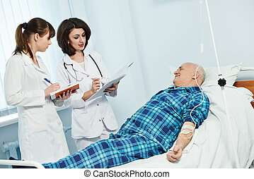 medic doctor in hospital with patient - young female doctor...