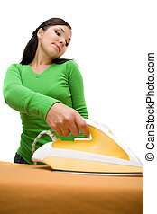 ironing woman - attractive brunette woman doing housework