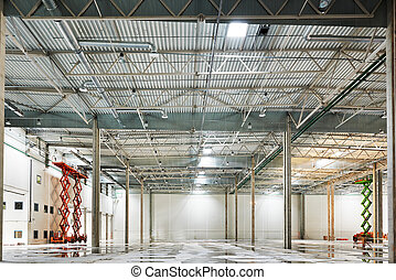 Empty warehouse under construction - modern empty storehouse...