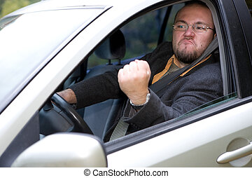 angry driver - angry man driving by car