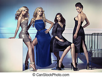 Fashion picture of four attractive female models - Fashion...