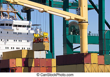 container ship - Harbor crane lifting a sea container from a...