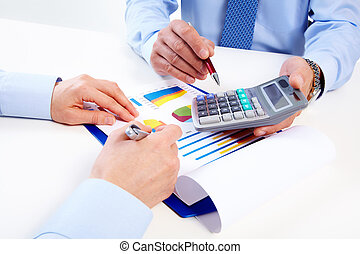 Hands of business people with calculator - Hand with...