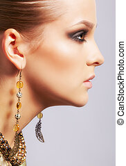 beautiful woman in ear-rings - sideview portrait of...
