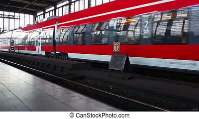 The train at the station in Berlin Red train out of the...